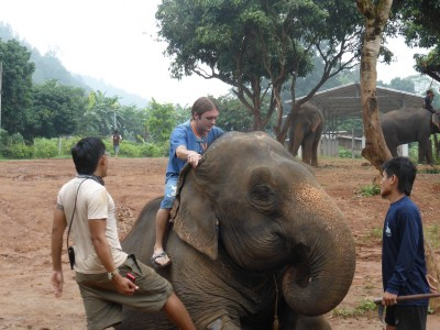 Me learning how to get on an elephant!